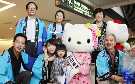 Chinese tourists with Japanese tourism mascot Hello Kitty at the Narita airport in Japan. The Japanese consulate in Hong Kong said the number of foreign travellers visiting the countryJapan exceeded 20 million in the first 10 months of this year. Photo: SCMP Pictures
