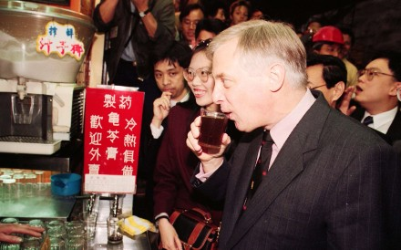 Then governor of Hong Kong, Chris Patten, sips a glass of herbal tea in Central, in 1993. Pictures: SCMP