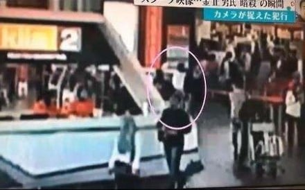A screenshot from a CCTV video shows a woman in white at Kuala Lumpur International Airport, moments before she pounces on a man identified as Kim Jong-nam. Photo: Fuji TV