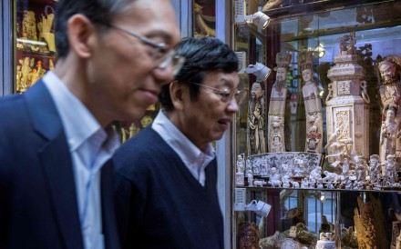 A file picture of pedestrians walking past a store selling ivory products in Hong Kong last December. Photo: AFP