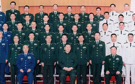 Xi Jinping (seated in centre) at the gathering of military leaders on Tuesday. Photo: Xinhua