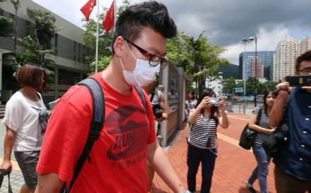 Li Haoxuan, one of six mainland tourists arrested at Hong Kong International Airport on suspicion of assaulting seven ground crew, appears at Tsuen Wan Court in 2015. Li was slapped with a HK$1,5000 fine after he pleaded guilty to causing a nuisance and annoyance by pouring water on a ground staff member the previous day. Photo: K.Y. Cheng