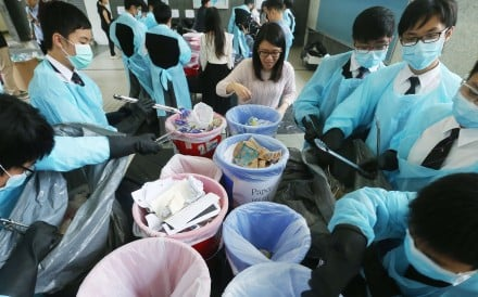 Pupils at La Salle College work on the waste reduction project. They cut schemethe number of rubbish bags used by between 37 and 46 per cent. Photo: K. Y. Cheng