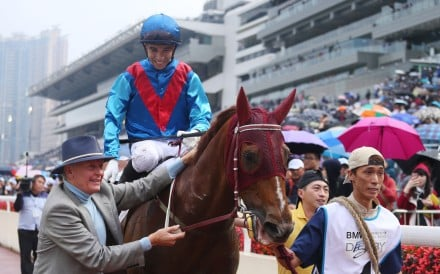 John Moore walks Rapper Dragon and Joao Moreira back after winning the BMW Hong Kong Derby. Photos: Kenneth Chan