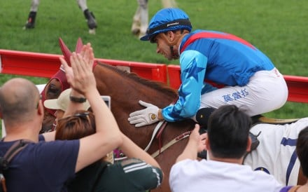 Rapper Dragon gets patted by Joao Moreira and applause from the fans after winning the Group Two Chairman's Trophy. Photos: Kenneth Chan