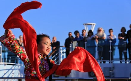 "A girl performs a folk dance during the opening ceremony of the ""Silk Road Stories"" programme on board the Majestic Princess cruise ship in Rome, Italy, on Sunday. Photo: Xinhua"