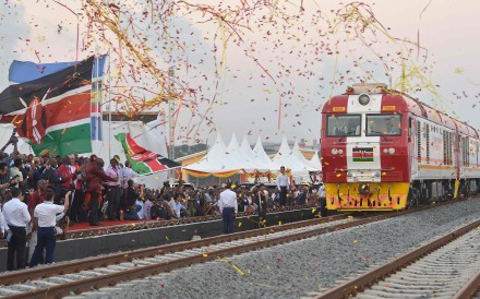 Kenyan President Uhuru Kenyatta flags off the train on the new Chinese-built railway. Photo: AFP