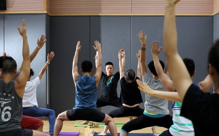Yoga classes have income a routine for many Hong Kong residents and executives to fend off stress and stay healthy. Photo: Nora Tam