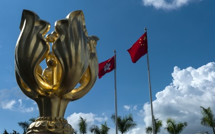 The flags of Hong Kong and China fly next to the Golden Bauhinia statue at the Convention and Exhibition Centre in Wan Chai. Hong Kong's new government would be well advised to focus on the different projects involved in the belt and road plan. Photo: EPA