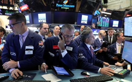 Traders in the New York Stock Exchange on July 19. Correlated world markets means there may be no place to hide. Photo: Reuters