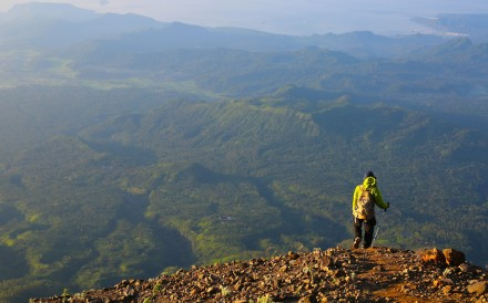 Hiking guide Wayan Ariana contemplates the views of Bali's coastline on the descent of Mount Agung. Photo: Graeme Green