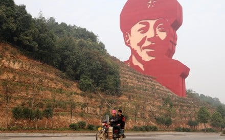 A 30-metre statue of Lei Feng dominates the horizon in Changsha, the hometown in Hunan province of the Cultural Revolution hero whose story has been used to instil the love of country in generations of Chinese students. Photo: Xinhua