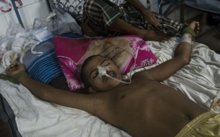 Rohingya refugee Mohammad Junaed is tied to a bed to stop him jumping out of it. Photo: AFP