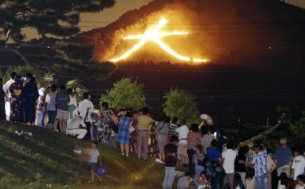 Kyoto's bonfire festival is popular with tourists. Photo: EPA