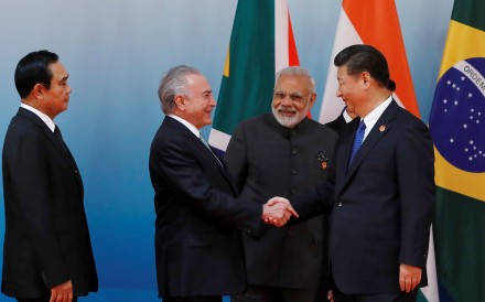 Chinese President Xi Jinping greets, from left to right, Thai Prime Minister Prayuth Chan-ocha, Brazilian President Michel Temer and Indian Prime Minister Narendra Modi. Photo: Reuters