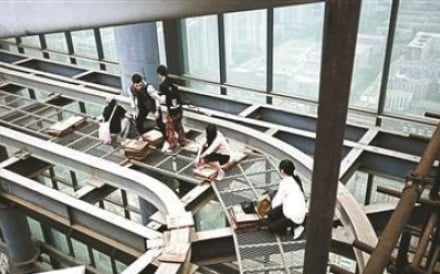 A photo posted online in April showed a group of young climbers sitting on steel racks at the top of one of the buildings. Photo: Handout