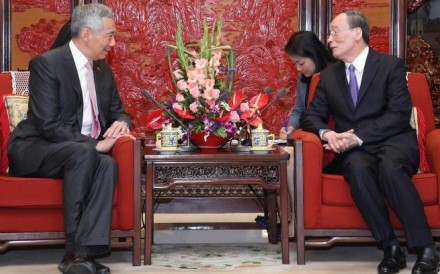 Singapore's Prime Minister Lee Hsien Loong (left) meets Wang Qishan in Beijing on Wednesday. Photo: Handout