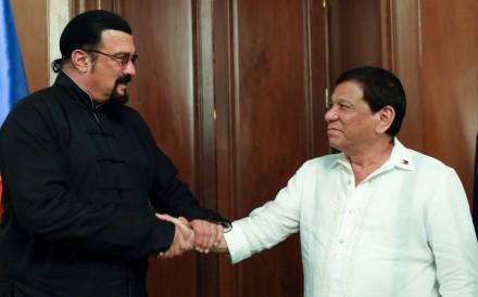 President Rodrigo Duterte greets visiting American actor Steven Seagal in Manila on October 12, 2017. Photo: Reuters
