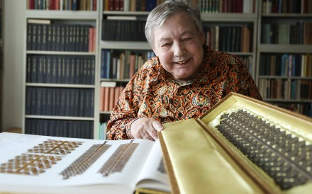 Numismatist Werner Burger with a part of his collection. Picture: Xiaomei Chen