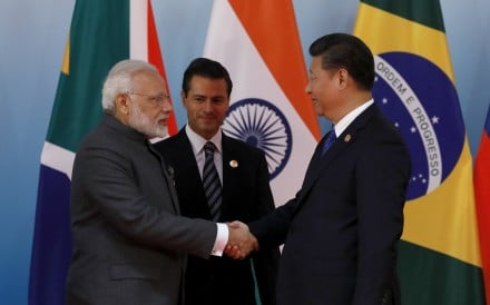 Indian Prime Minister Narendra Modi (left) greets Chinese President Xi Jinping while Mexican President Enrique Pena Nieto looks on, during the 2017 BRICS Summit in Xiamen, China, on September 5. Photo: EPA-EFE