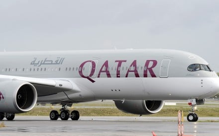The first Airbus A350 bears the Qatar airline company logo on the tarmac of Toulouse Blagnac airport, southwestern France in 2014. Photo: AFP