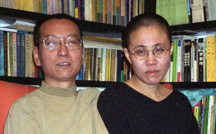 Campaigners are calling for the release of Liu Xia, pictured with her Nobel laureate husband Liu Xiaobo in 2002, who has yet to be given her freedom four months after her husband's death. Photo: AFP