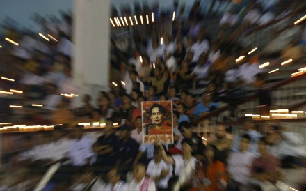 People hold a portrait of Myanmar state counsellor Aung San Suu Kyi at a prayer gathering in Yangon. Photo: EPA