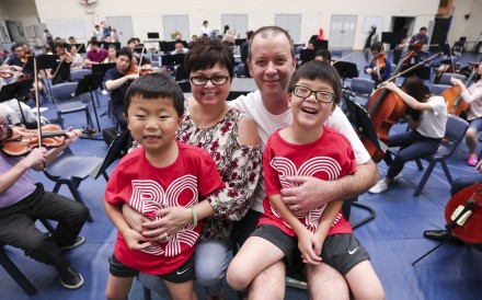 Seven-year-old Jaden Martin; Tammy Martin; Barry Martin; and 6-year-old Nathan Martin, at the MedArt biannual charity concert orchestral rehearsals at Yew Chung Secondary School in Kowloon Tong. Photo: Jonathan Wong