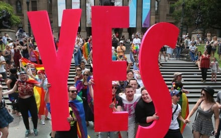 Celebrations in Melbourne after the announcement of the results of a postal survey on legalising same-sex marriage, in front of the State Library of Victoria on November 15. More than 60 per cent of Australians voted in favour in the voluntary survey. Photo: EPA-EFE