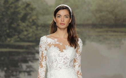 Studio St. Patrick uses lace in its long sleeved wedding gowns available at Hitched! Bridal.