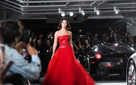 Model Bella Hadid dress in a red Ralph Lauren gown at the Ralph Lauren autumn 2017 collection runway show in New York in September 2017.