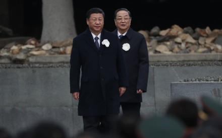 Chinese President Xi Jinping (left) and Chinese People's Political Consultative Conference chairman Yu Zhengsheng attend commemorations in Nanjing on Wednesday, the 80th anniversary of the Nanking massacre. Photo: EPA