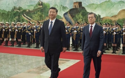 Xi Jinping welcomes his South Korean counterpart Moon Jae-In to the Great Hall of the People on Thursday. Photo: EPA-EFE