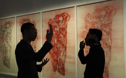 Artist Ni Youyu talks to Hung Fai, whose work The Six Principles of Chinese Painting – Transmission IV hangs behind them, at the M+ Pavilion of the West Kowloon Cultural District. Photo: Nora Tam