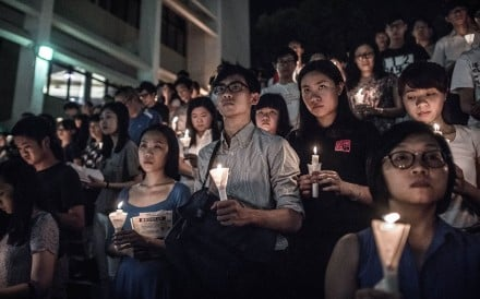 Participants hold candles during a vigil organised by students to commemorate the 1989 Tiananmen Square crackdown at the University of Hong Kong, in June 2015. Photo: AFP