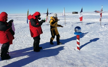 Chinese tourists take photographs of the metal sphere at the South Pole. Photo: Pavel Toropov