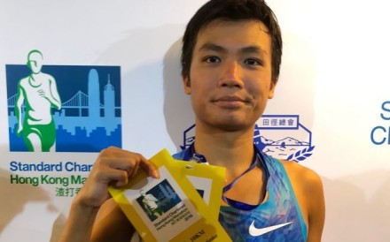Abraham Kok Yu-hang, winner of the men's 10km race at the 2018 Hong Kong Marathon. Photo: Chan Kin-wa