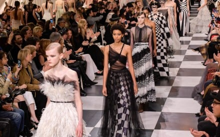 Christian Dior's haute couture spring summer show takes place inside a huge cube covered in a checkered pattern