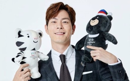 Korean actor Hong Jong-hyun with official mascots Soohorang and Bandabi, who feature on Winter Olympics-themed clothing and accessories ranging from cutely designed gloves to toques and T-shirts.