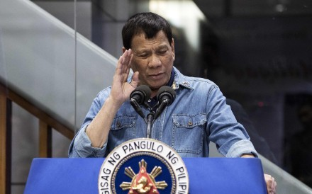 Philippine President Rodrigo Duterte (seen on February 13) has tried to quell fears over Chinese military development in the Spratly Islands, saying it's only to defend against the US, not attack China. File photo: AFP