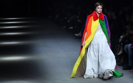 British model Cara Delevingne presents a creation from the Burberry collection at London Fashion Week Autumn/Winter 2018 range in London. Photo: AFP