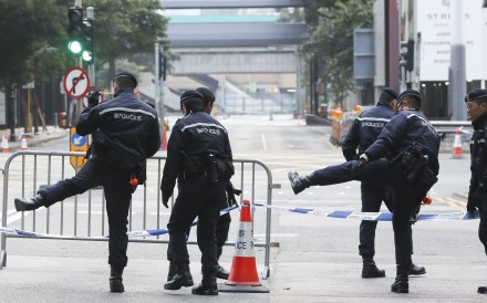 Police cordon off the area to divert traffic, as bomb disposal experts are deployed to the Sha Tin-Central rail link construction site in Wan Chai, on February 1. Photo: Sam Tsang