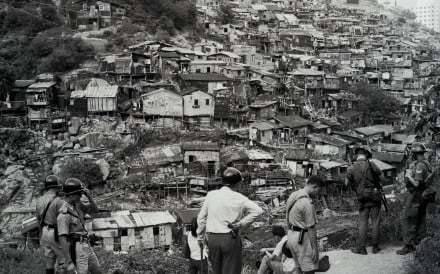 Police getting ready to conduct a raid on squatter huts on Mount Butler, near the Tai Tam Reservoir on Hong Kong Island, in 1967. Photo: Robin Lam