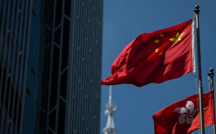 The People's Republic of China flag (top) and the Hong Kong SAR flag (bottom). Photo: EPA-EFE
