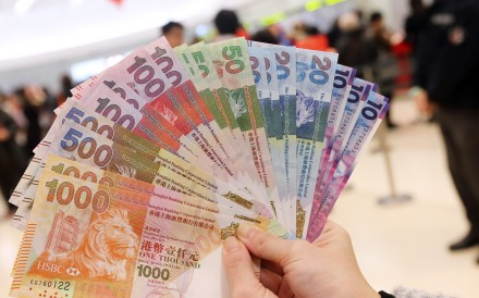 New banknotes for red packets for the Lunar New Year at a bank in Mong Kok on 27 January, 2016. Photo: SCMP/David Wong