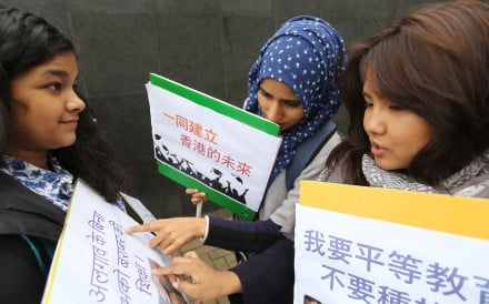Young women from Hong Kong's ethnic minority communities check their placards before submitting their wish list for the policy address to then chief executive Leung Chun-ying in 2017. Photo: Xiaomei Chen