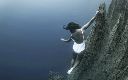 Freediver Gen Abanilla takes in the view at Barracuda Lake, Coron, the Philippines. Photo: Toby Kulot