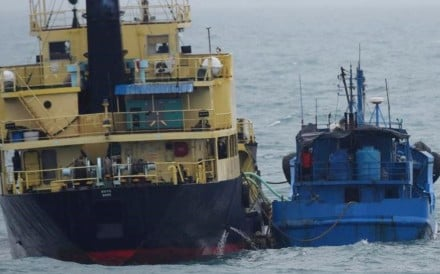 FILE - This Feb. 16, 2018, file photo released by Japan's Ministry of Defense shows what it says North Korean-flagged tanker Yu Jong 2, left, and Min Ning De You 078 lying alongside in the East China Sea performing a ship-to-ship transfer. China's government said Tuesday, March 6, 2018, it asked for a temporary hold on a U.S. request for United Nations sanctions against ships accused of violating trade restrictions on North Korea while it studies what entities are involved. (Ministry of Defense via AP, File)