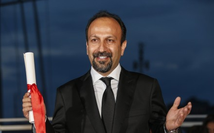 Iranian director Asghar Farhadi after winning the best screenplay award for Forushande (The Salesman) at the 69th Cannes Film Festival in 2016. Photo: EPA-EFE/Julien Warnand