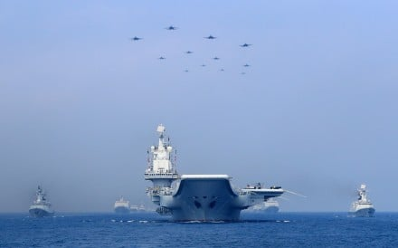 Chinese warships and fighter jets take part in a military display in the South China Sea on April 12. Photo: Reuters